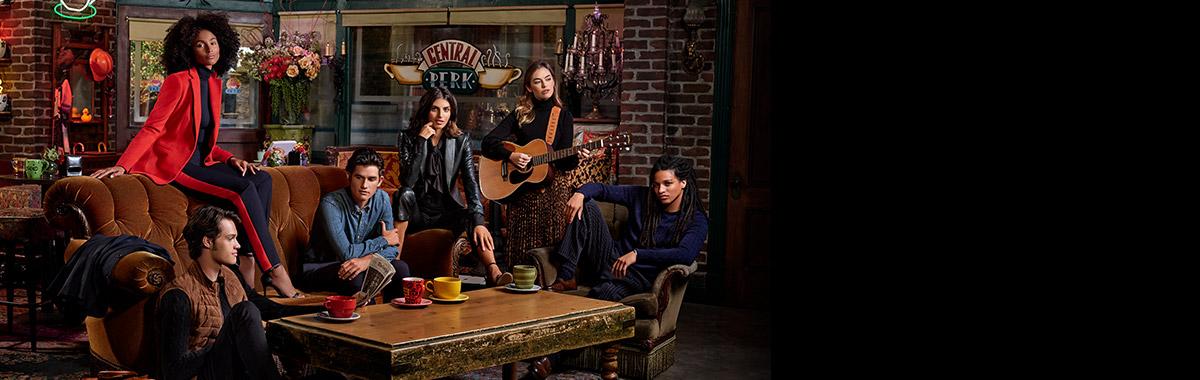 Models in Ralph Lauren channeling cast of Friends in Central Perk café