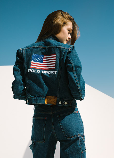 Woman in Polo Sport denim jacket with American flag motif at back