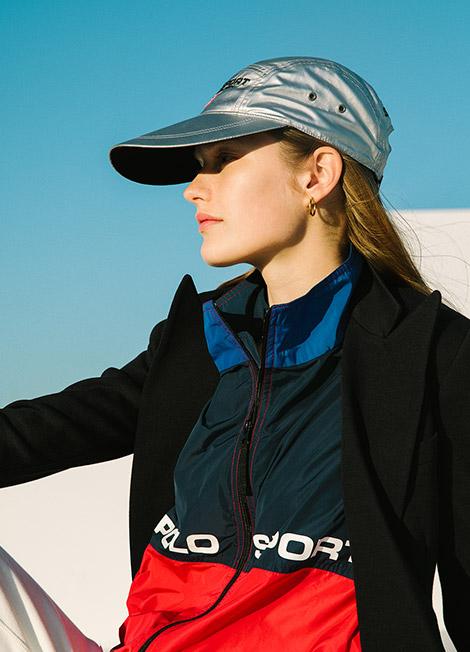 Woman in metallic cap & color-blocked Polo Sport jacket