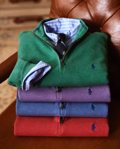 Stack of folded quarter-zips in different colors, with Polo Pony accents