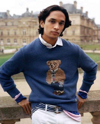 Man in blue Polo Bear sweater