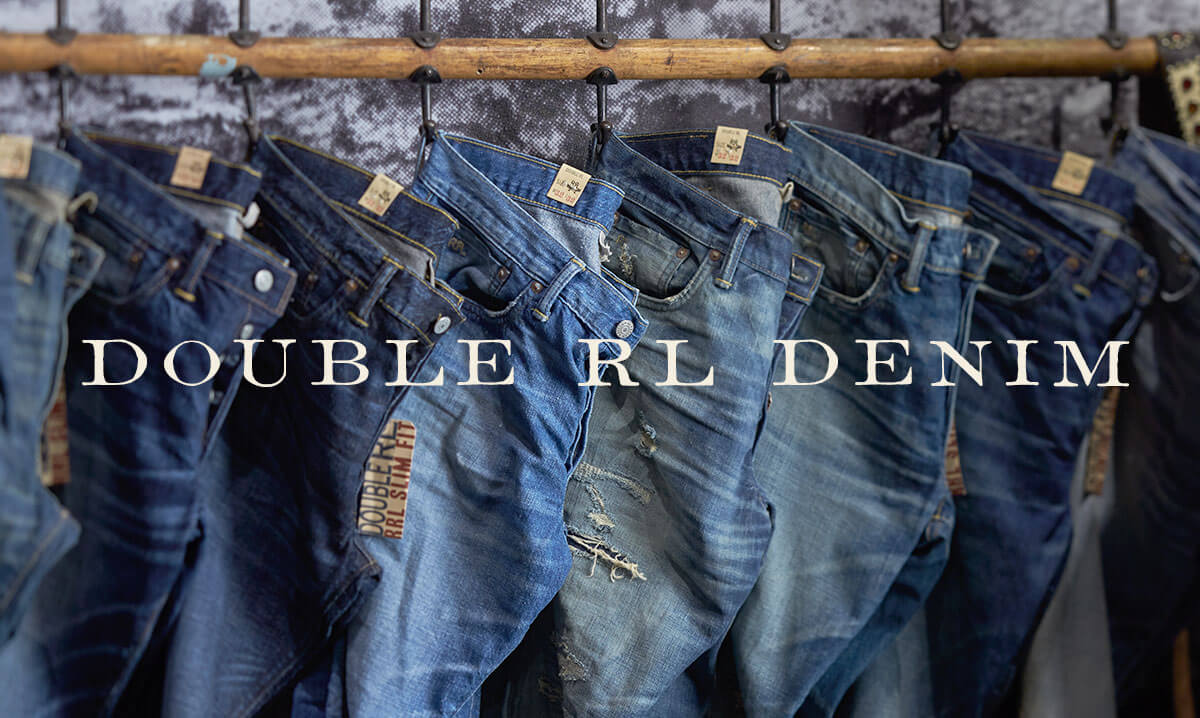 Row of denim of various washes & fits hanging on hooks