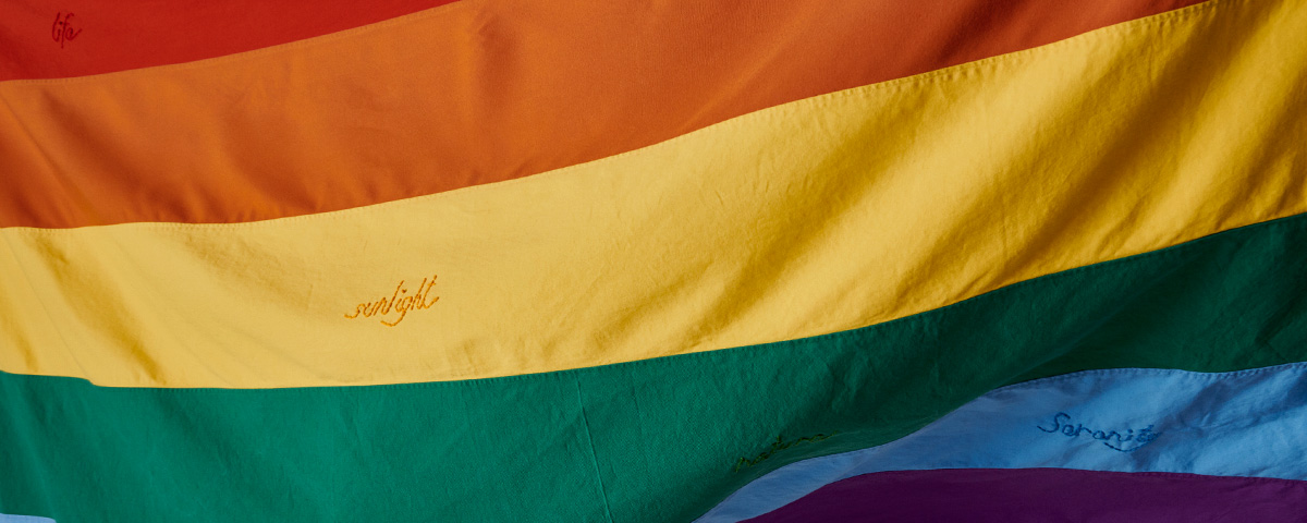 Close up photograph of rainbow flag