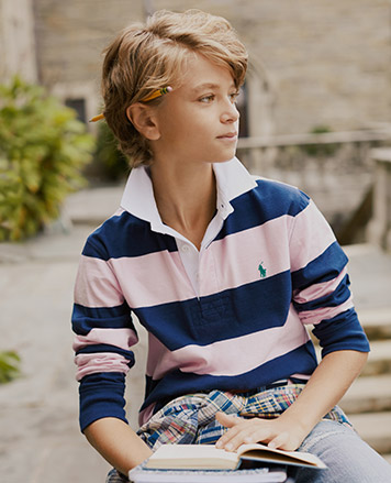 Boy wears navy and light pink long-sleeve rugby shirt.