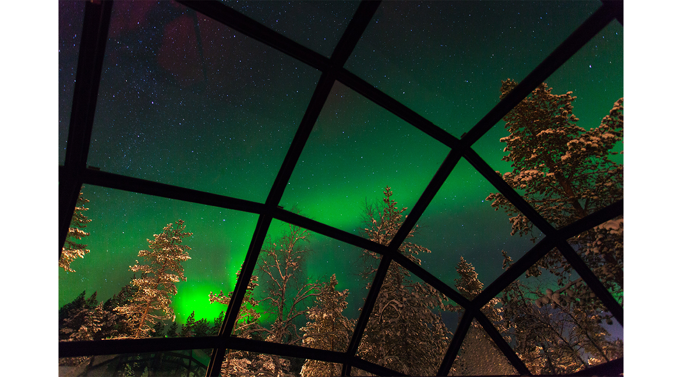 The aurora borealis, enjoyed from the comforts of a glass igloo.