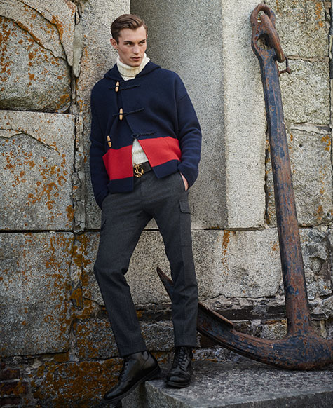 Man in cropped navy jacket with toggle closures & red stripe