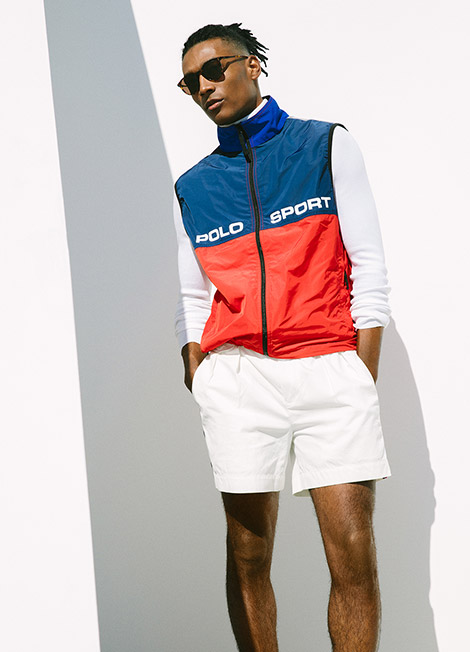 Man in color-blocked blue and red performance vest