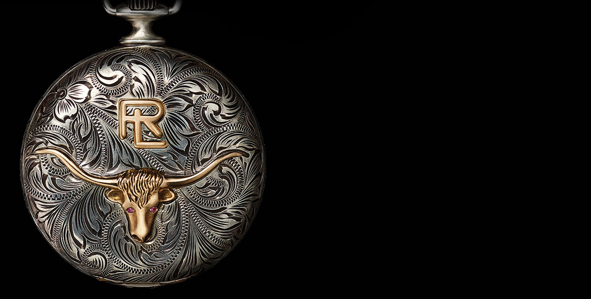 Pocket watch with intricate floral engravings and steer-head motif