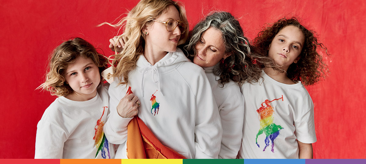 7c2818e70 Women and children wear white tees and sweatshirts with rainbow ponies at  the chest.
