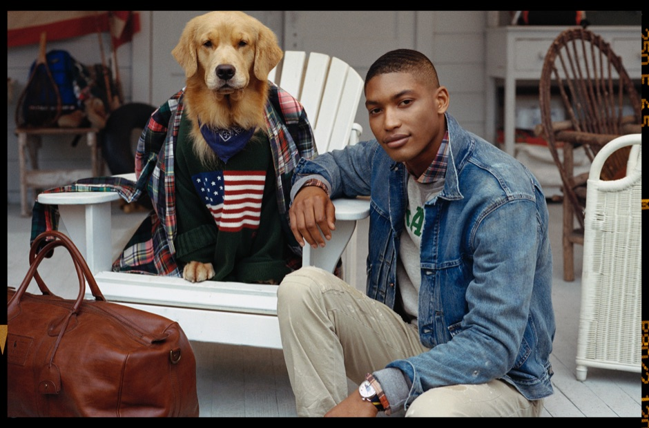 Golden retriever in American flag sweater & man in denim jacket